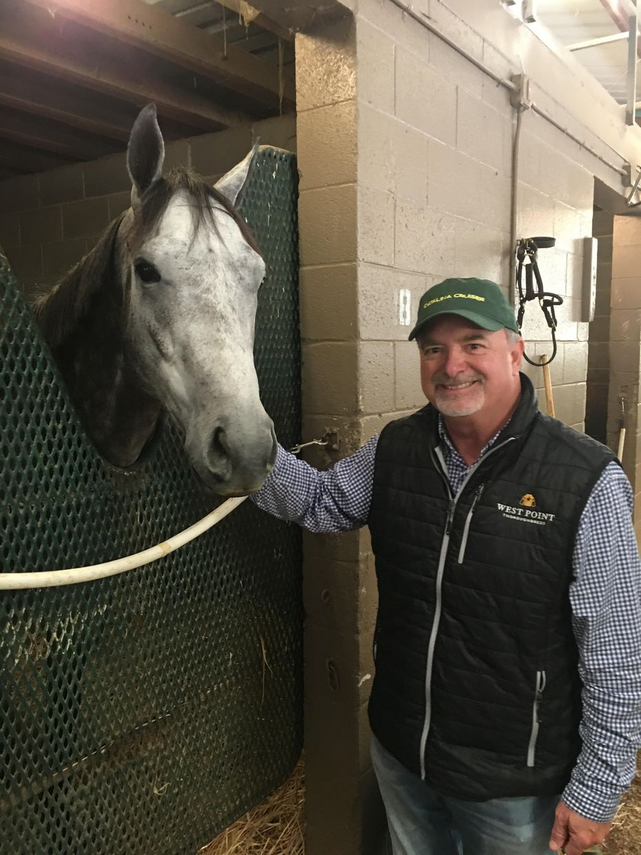 Michael Grimm of Fort Worth stands with his horse Winning Impression, a surprise entrant in the Kentucky Derby. Grimm co-owns the horse with Kevin Mahoney, also of Fort Worth.