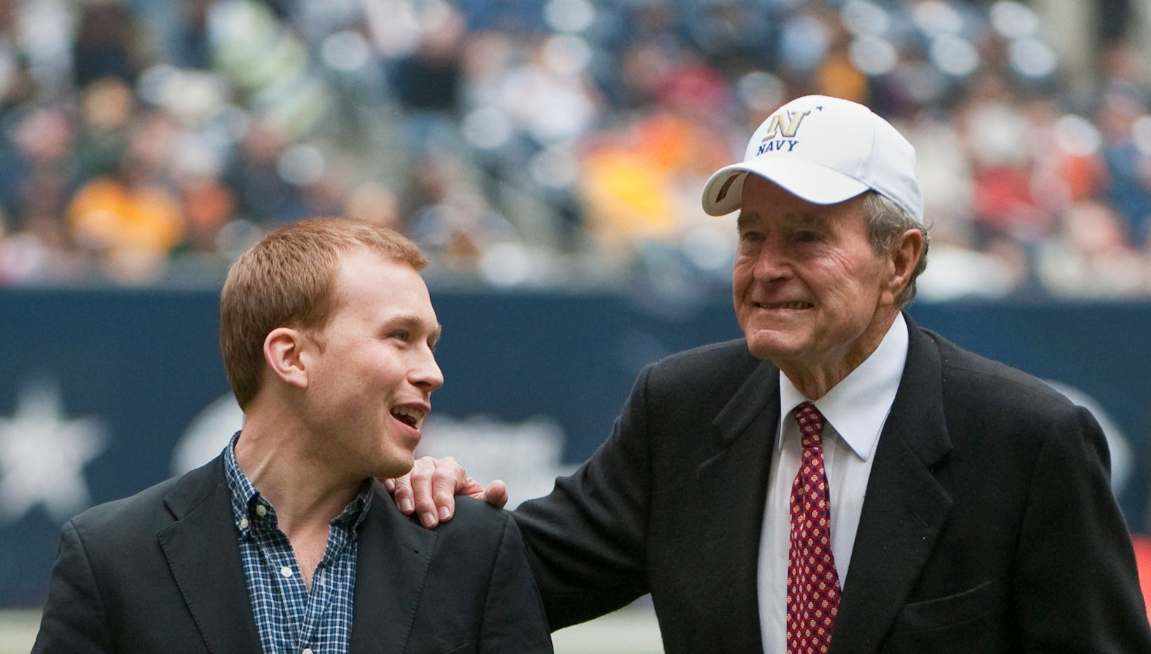 In this Dec. 31, 2009 photo, former President George H. W. Bush leaves the field with the help of Pierce Bush, his grandson, before the Texas Bowl NCAA college football game in Houston. Pierce Bush announced Dec. 9, 2019 that he'll run in the Republican primary for a congressional seat near Houston.