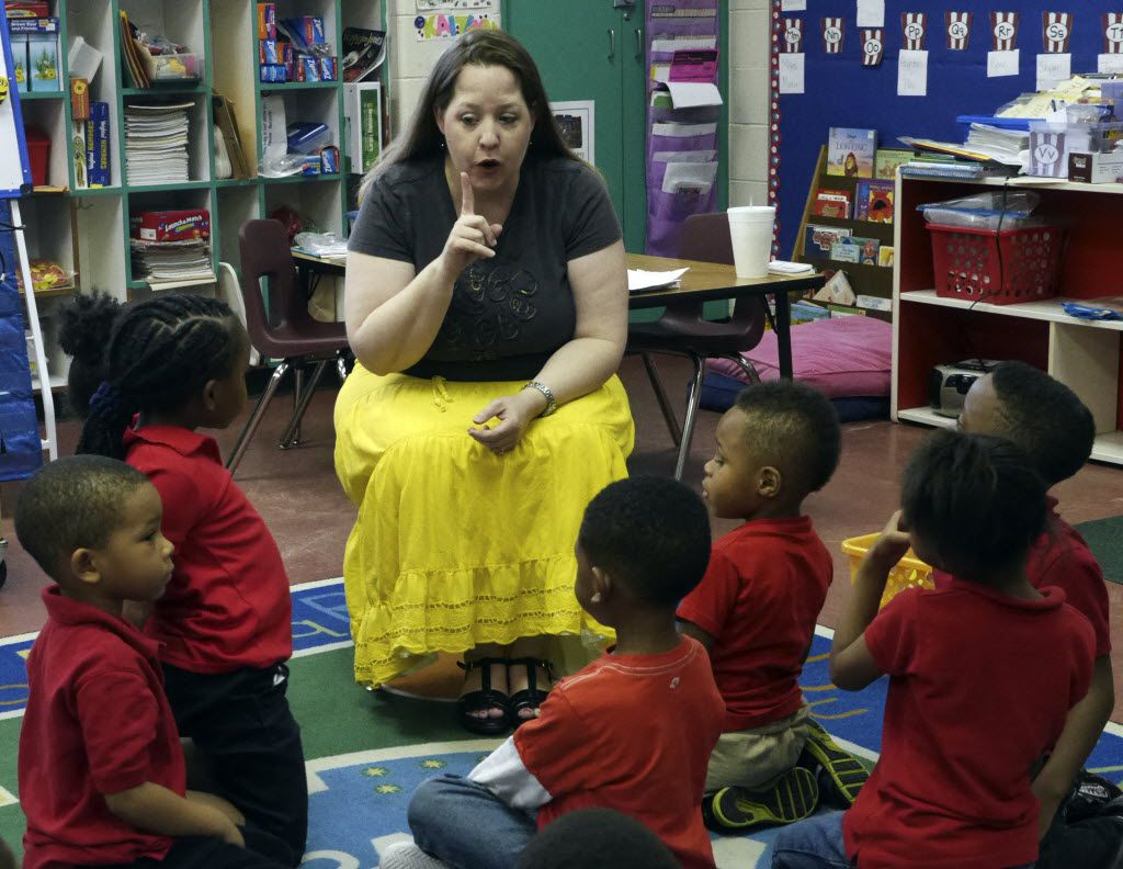 Sara Tinsley, a DISD certified teacher, works with her pre-k class at Good Street Learning Center Thursday April 3, 2014. The center is in partnership with Dallas ISD and offers a half-day Pre-K at the center. DISD has placed a certified teacher at the school to teach two Pre-K classes (Ron Baselice/ The Dallas Morning News)