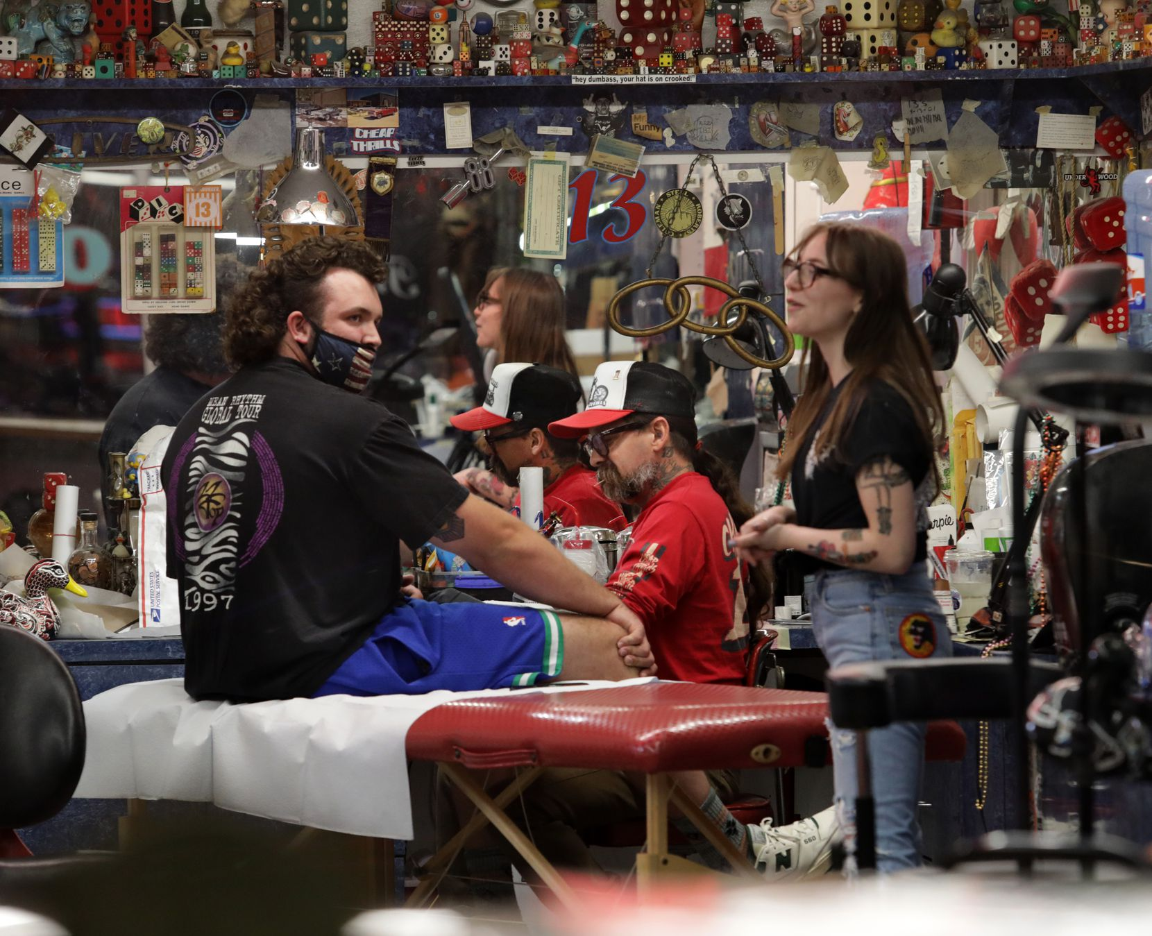 Guests and employees enjoy the evening at Deep Ellum's Elm Street Tattoos in Dallas, TX, on Mar. 10, 2021.