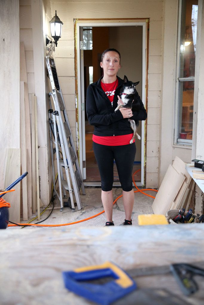 Laura Reed, with her dog Toby, and her husband didn't get flood insurance when they bought their Katy home six years ago. And they're still trying to rebuild from damage caused by Hurricane Harvey.