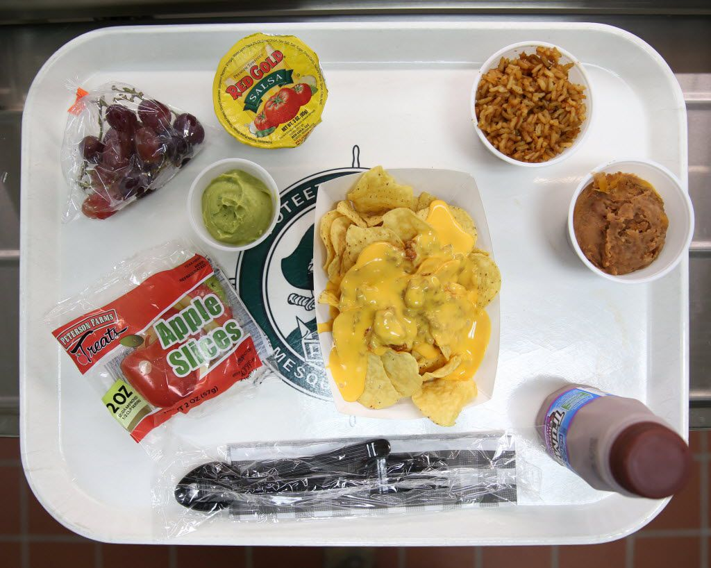This school lunch offers nachos with a side of beans, rice, apple slices, grapes, salsa and guacamole at Mesquite ISD's Poteet High School. The lunch meals for high school students range from 750 to 850 calories. (Rose Baca/Staff Photographer)