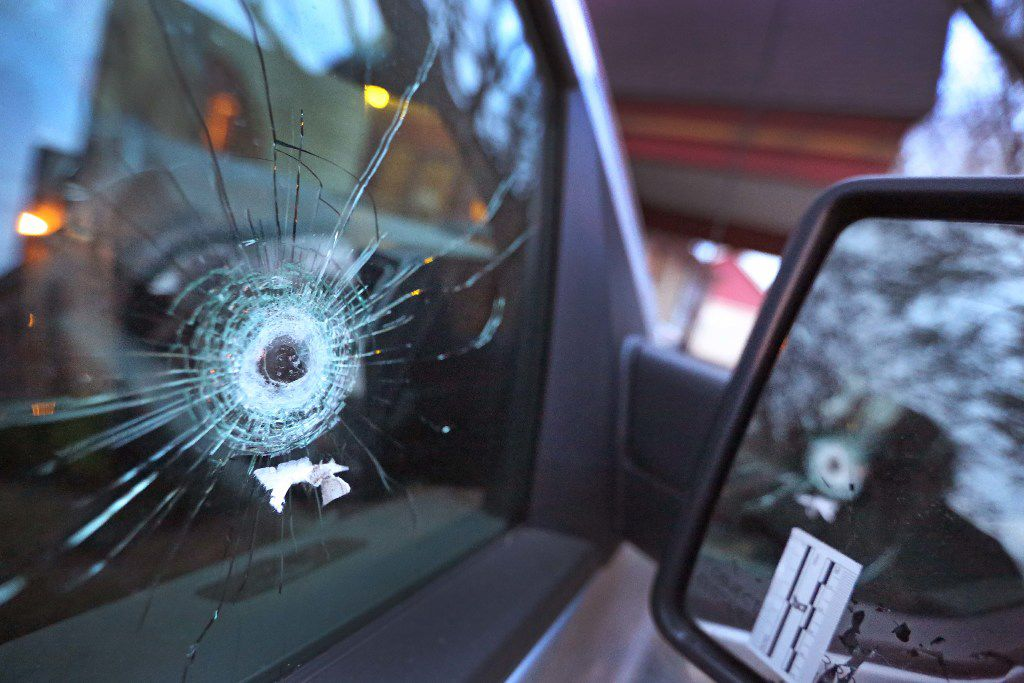 A bullet hole is seen in the passenger window of Posey's truck. Posey, the artistic director of Ochre House Theater, was shot in the leg and the face on Jan. 30. He will resume performing on March 8.
