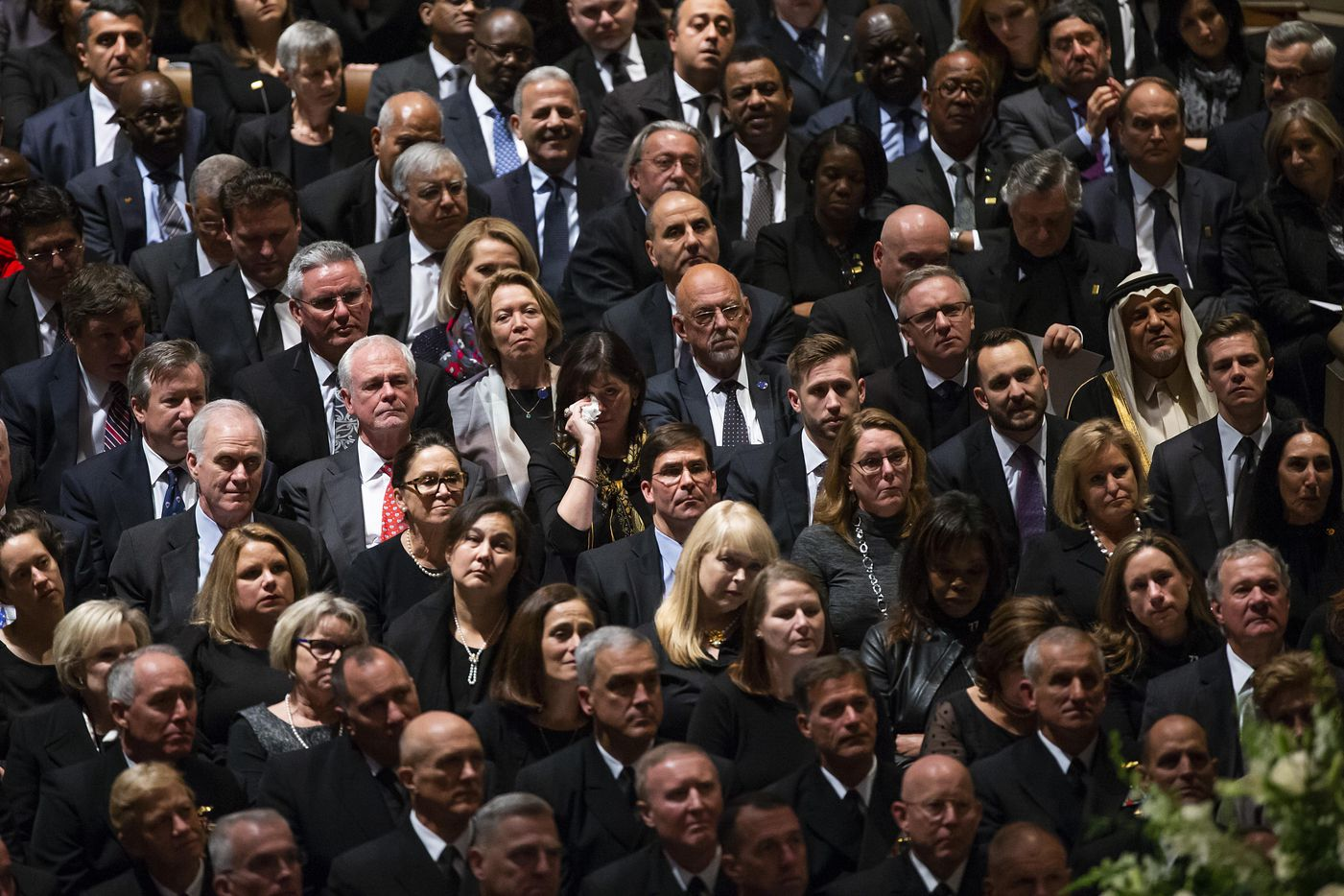 A woman wipes her eyes as former President George W. Bush delivers a eulogy during the State Funeral for his father George H.W. Bush, the 41st President of the United States, at the Washington National Cathedral on Wednesday, Dec. 5, 2018, in Washington. (Smiley N. Pool/The Dallas Morning News)