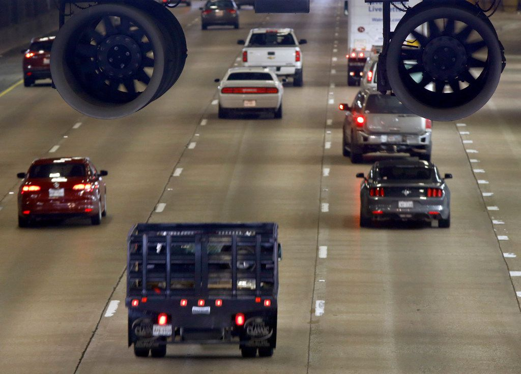 Vehicles on Woodall Rodgers Freeway pass under Klyde Warren Park where large fans are hung in Dallas, Tuesday, October 16, 2018.  Kit Sawers, president of Klyde Warren Park, said the fans help remove carbon dioxide from the tunnel and will help remove smoke if there is ever a fire in the tunnel.