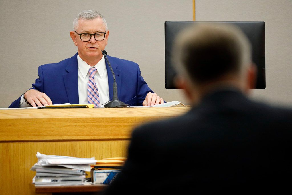 Retired Deputy Chief Craig Miller answers questions Saturday from lead prosecutor Jason Hermus in the 204th District Court at the Frank Crowley Courts Building in Dallas.