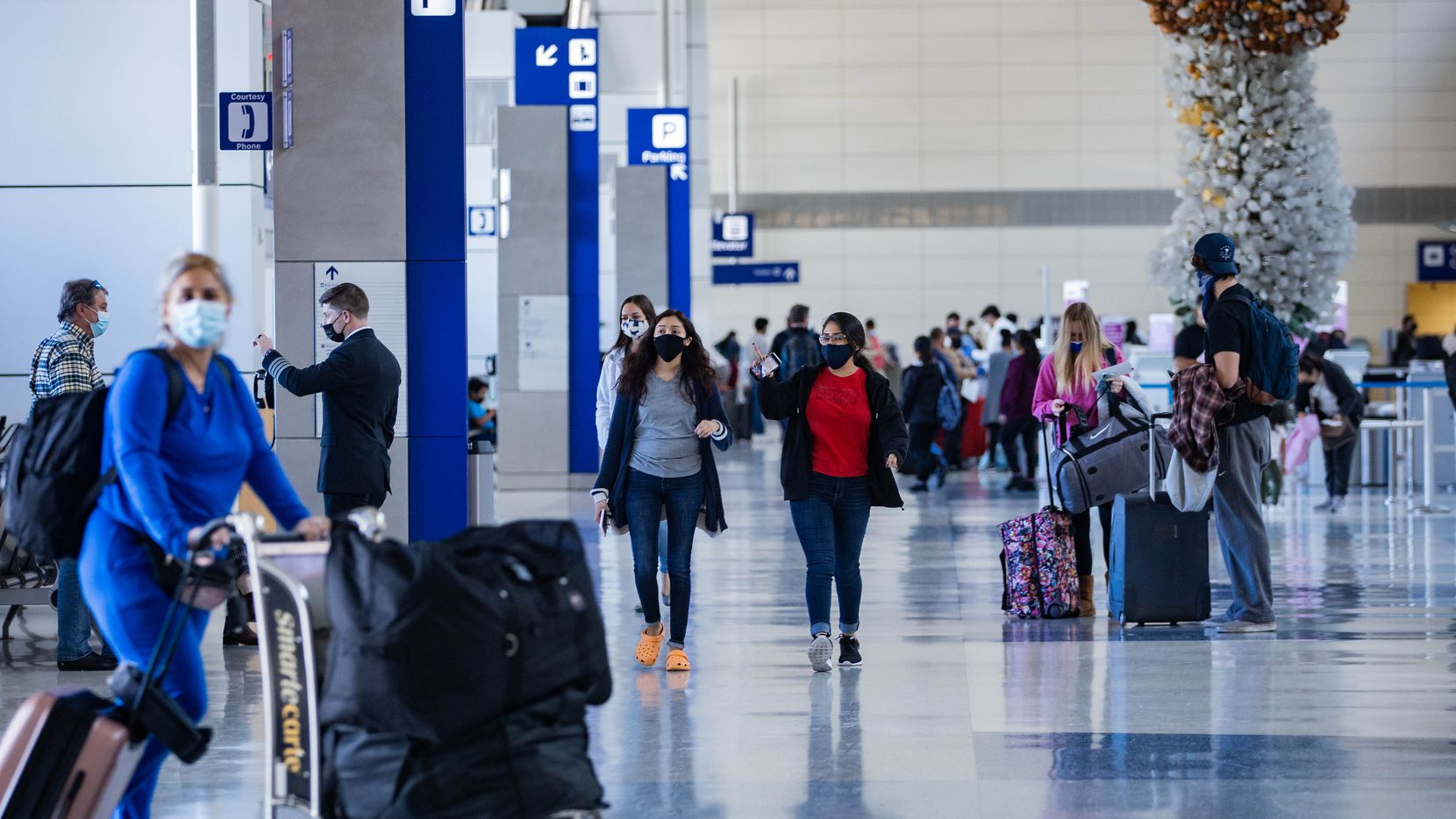 Travelers at Terminal D the day before Thanksgiving at DFW International Airport on Nov. 25.