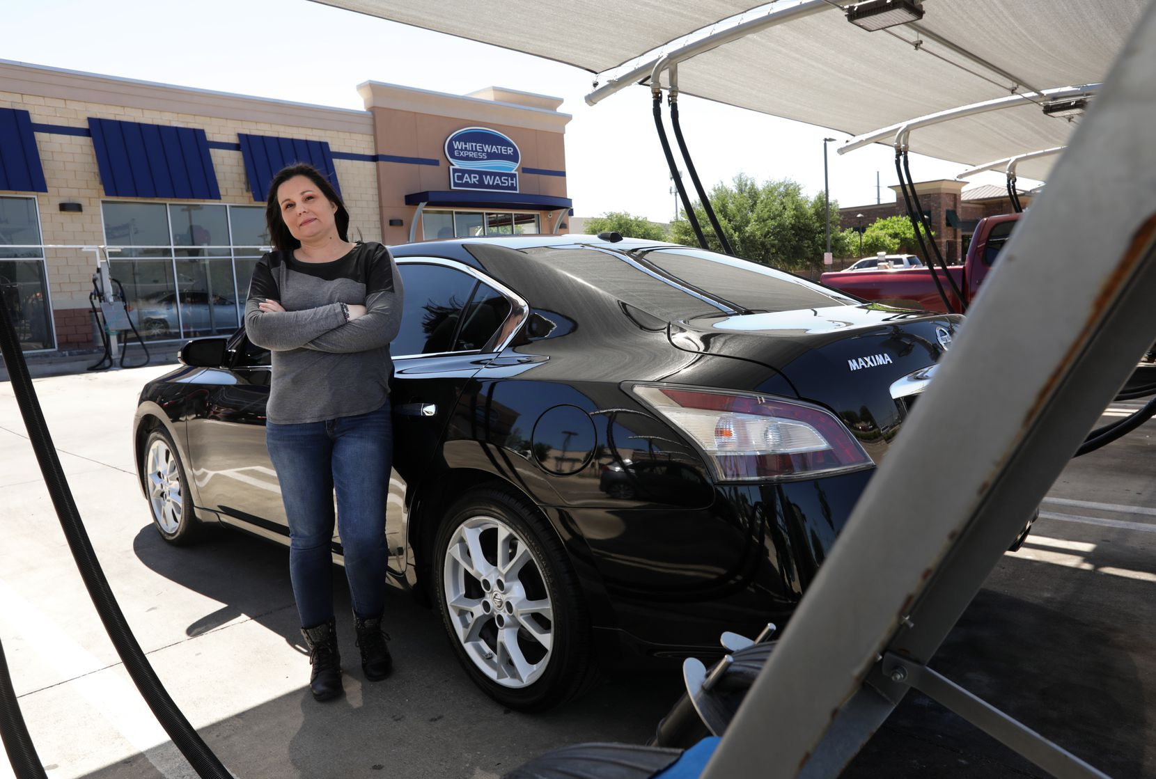 Trisha Musgrave made less than $4.20 on her last day of driving for Uber six weeks ago when she stopped getting calls for rides. She remains a loyal patron of WhiteWater Express Car Wash in Plano, which she uses to keep her car clean as a full-time ride-sharing driver.