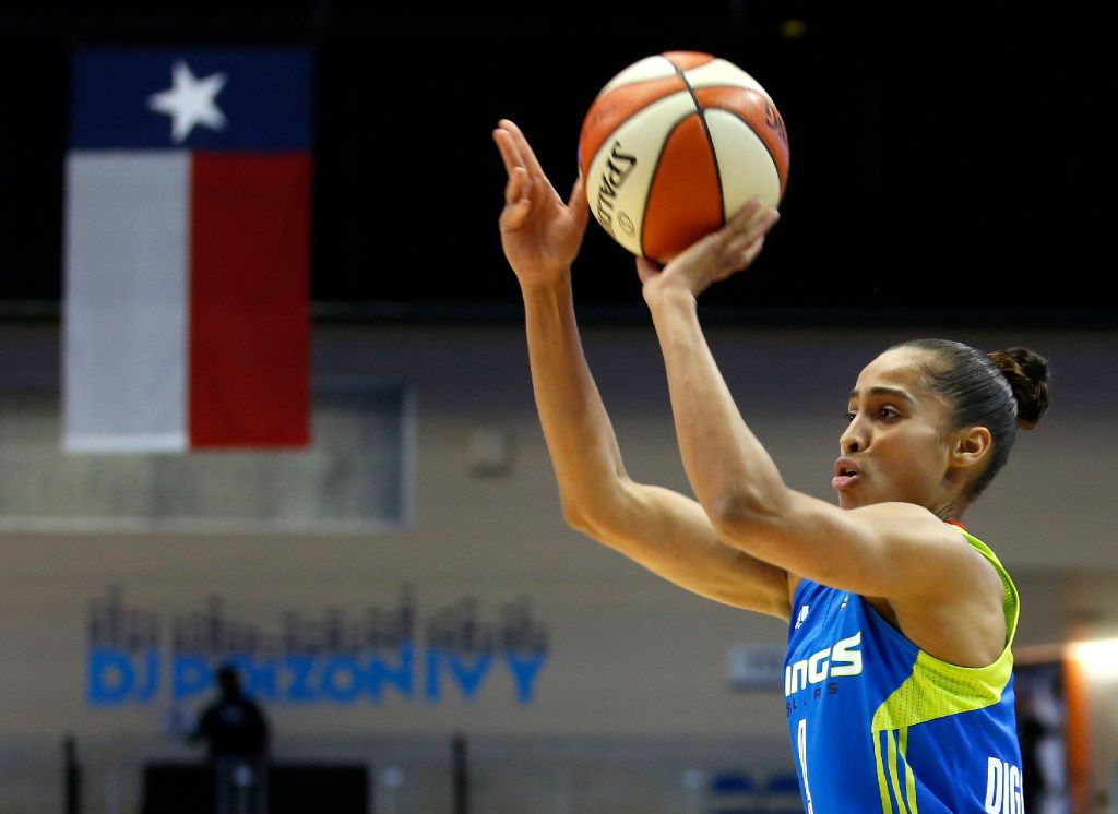 Dallas Wings guard Skylar Diggins-Smith (4) takes a jump shot in a game against the Washington Mystics during the first half of play at UTA's College Park Center in Arlington on Tuesday, June 6, 2017. (Vernon Bryant/The Dallas Morning News)