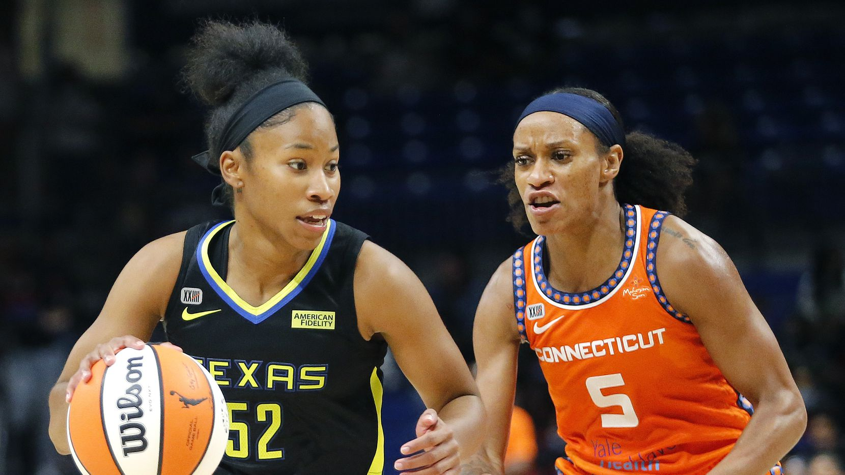 Dallas Wings guard Tyasha Harris (52) drives past Connecticut Sun guard Jasmine Thomas (5) during the first half as the Dallas Wings hosted the Connecticut Suns at College Park Center in Arlington on Sunday, August 15, 2021.