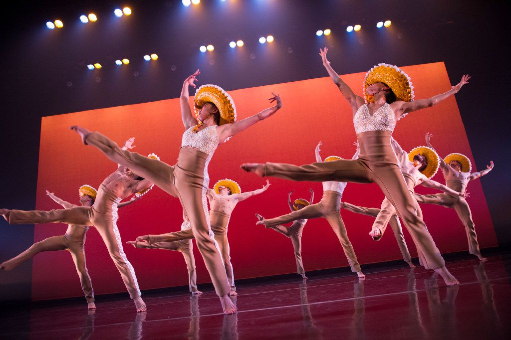 Ballet Hispánico dancers don sombreros and mariachi-style costumes in Michelle Manzanales' Con Brazos Abiertos.