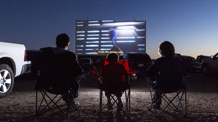 People watch a movie in this file photo of Stars & Stripes Drive-In Theater in New Braunfels, Texas. A Richardson business owner recently opened his own drive-in theater to bring business to his two bars.