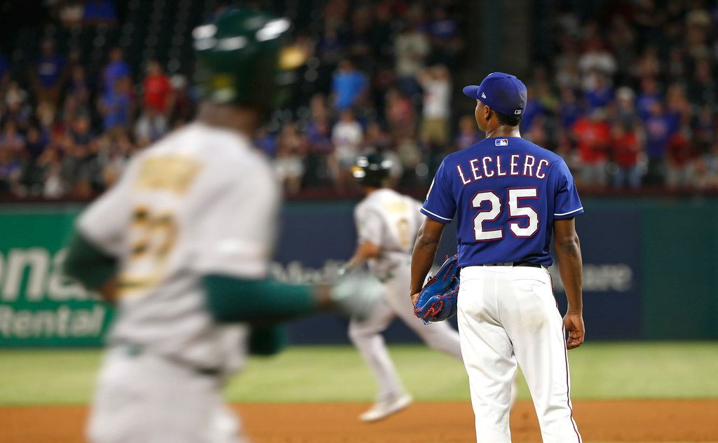 ARLINGTON, TX - JUNE 7: Jose Leclerc #25 of the Texas Rangers looks on after giving up a two run home run to Marcus Semien #10 of the Oakland Athletics during the ninth inning at Globe Life Park in Arlington on June 7, 2019 in Arlington, Texas. The Athletics won 5-3. (Photo by Ron Jenkins/Getty Images)