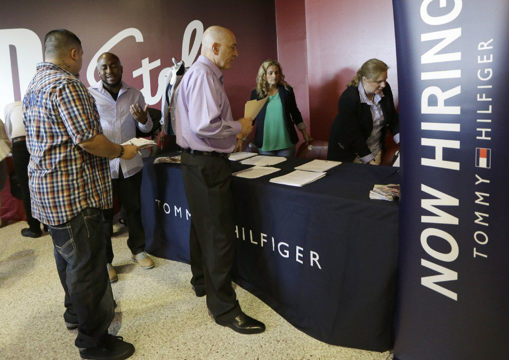 FILE - In this June 10, 2015, file photo, job seekers attend a job fair in Sunrise, Fla. On Thursday, June 15, 2017, the Labor Department releases weekly jobless claims. (AP Photo/Alan Diaz)