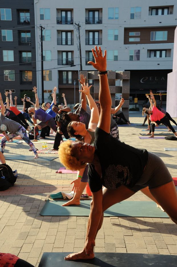 Yogis practice extended triangle pose at the D-FW Free Day of Yoga Kickoff at the Latino Cultural Center in Dallas, TX on September 3, 2016. (Alexandra Olivia/ Special Contributor)