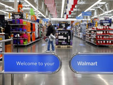 A gate welcomes shoppers to the Walmart Supercenter on Lyndon B. Johnson Freeway in Dallas.