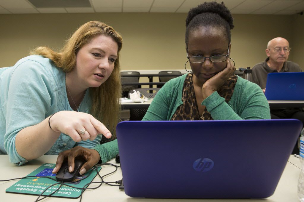 Teachers Kelley Andrews (left) and Candace Edmerson attended a week-long UTeach programming and coding camp this month at the University of Texas at Dallas in Richardson.