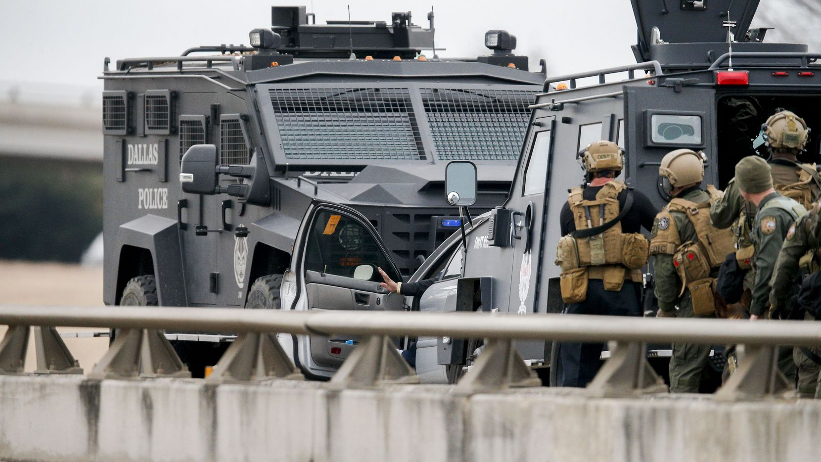 SWAT officers prepare to take a suspect into custody during a standoff on I-20 at I-35E, Friday, January 8, 2021. The suspect was taken into custody peacefully. (Brandon Wade/Special Contributor)