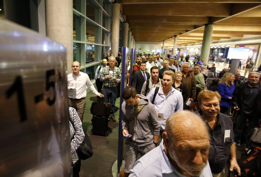 Passengers wait to board Southwest Airlines flight at Dallas Love Field. (Vernon Bryant/The Dallas Morning News)