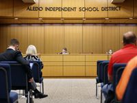 "Aledo school police are investigating racist flyers found near the high school a week after students were disciplined for conducting a mock ""slave trade."""