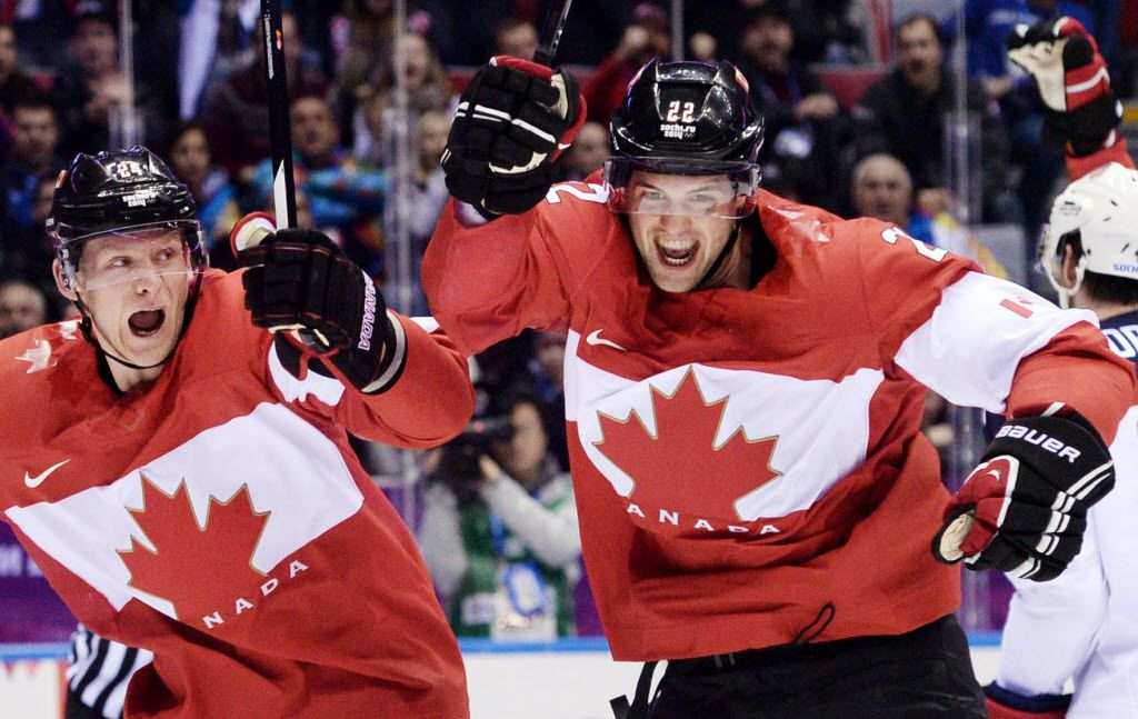 Canada's Jamie Benn (right) celebrates scoring his team's first goal during the Men's Ice Hockey Semifinal match between the USA and Canada at the Bolshoy Ice Dome during the Sochi Winter Olympics on February 21, 2014. At left is Canada's Corey Perry, who plays for the Anaheim Ducks. (AFP PHOTO / ANDREJ ISAKOVICANDREJ ISAKOVIC/AFP/Getty Images) 02222014xSPORTS