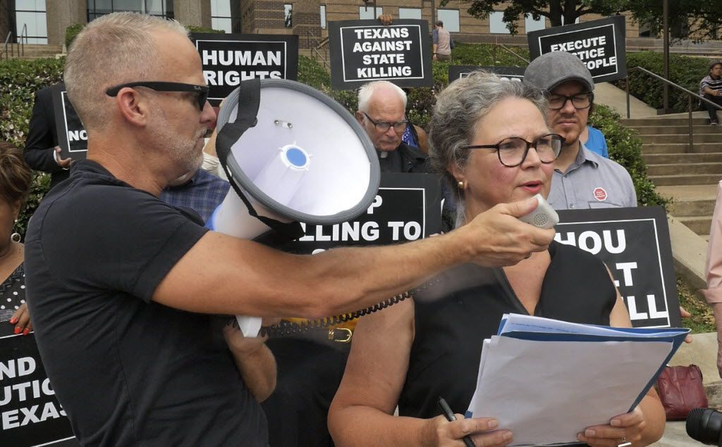 Todd Whitley held the bullhorn microphone for Susybelle Lyons Gosslee as faith leaders and concerned citizens gathered on the front steps of the Frank Crowley Courts Building in 2014 to protest the death penalty.