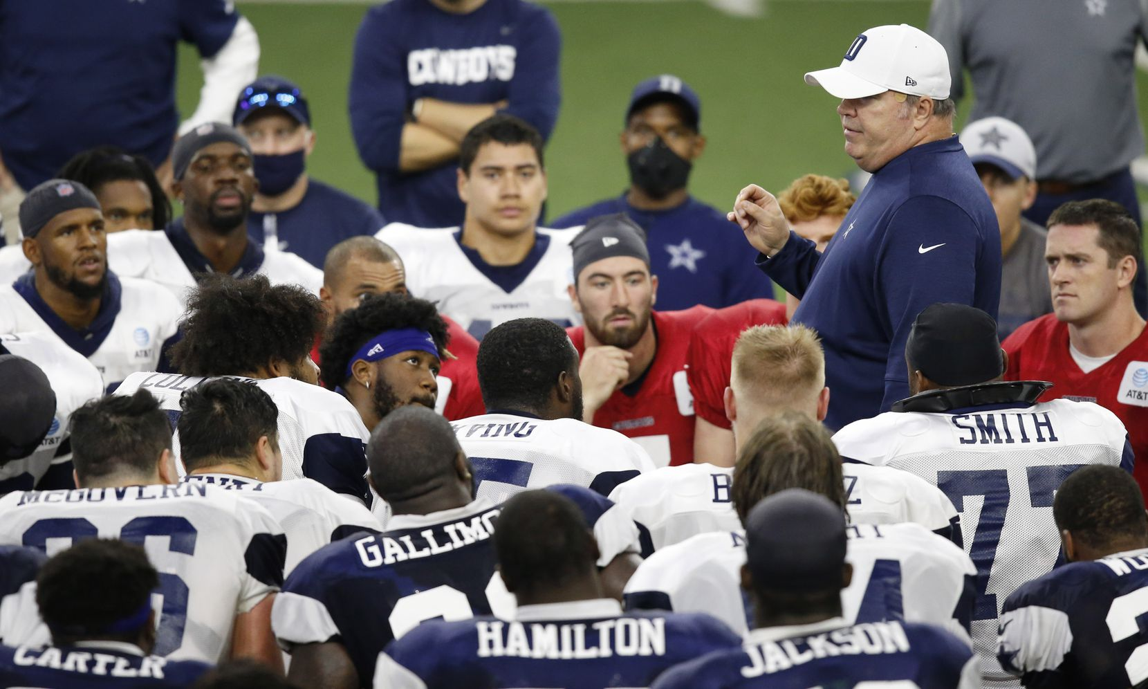 Dallas Cowboys head coach Mike McCarthy talks to the players after practice during training camp at The Star in Frisco, Texas on Thursday, August 27, 2020.