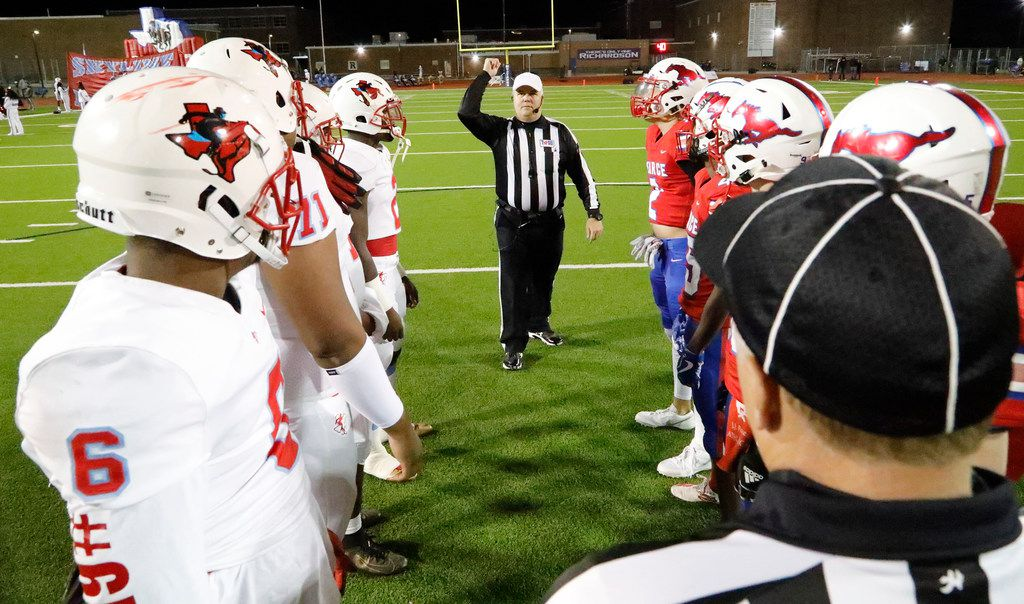 Team captains gather at midfield for the coin toss as J.J. Pearce High School hosted Skyline High School at Eagle/Mustang Stadium in Richardson on Friday night, November 8, 2019. (Stewart F. House/Special Contributor)