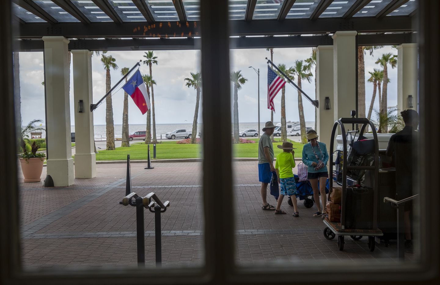 A  family arrives on July 15 at the Grand Galvez in Galveston.