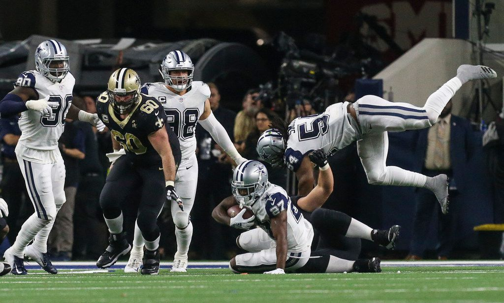Dallas Cowboys cornerback Jourdan Lewis (27) intercepts the ball during the second half of a matchup between the Dallas Cowboys and the New Orleans Saints on Thursday, Nov. 29, 2018 at AT&T Stadium in Arlington, Texas. (Ryan Michalesko/The Dallas Morning News)