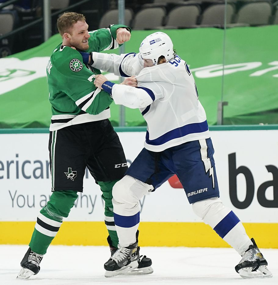 Dallas Stars defenseman Jamie Oleksiak (left) fights with Tampa Bay Lightning defenseman Luke Schenn during the second period of an NHL hockey game at the American Airlines Center on Thursday, March 25, 2021, in Dallas. (Smiley N. Pool/The Dallas Morning News)