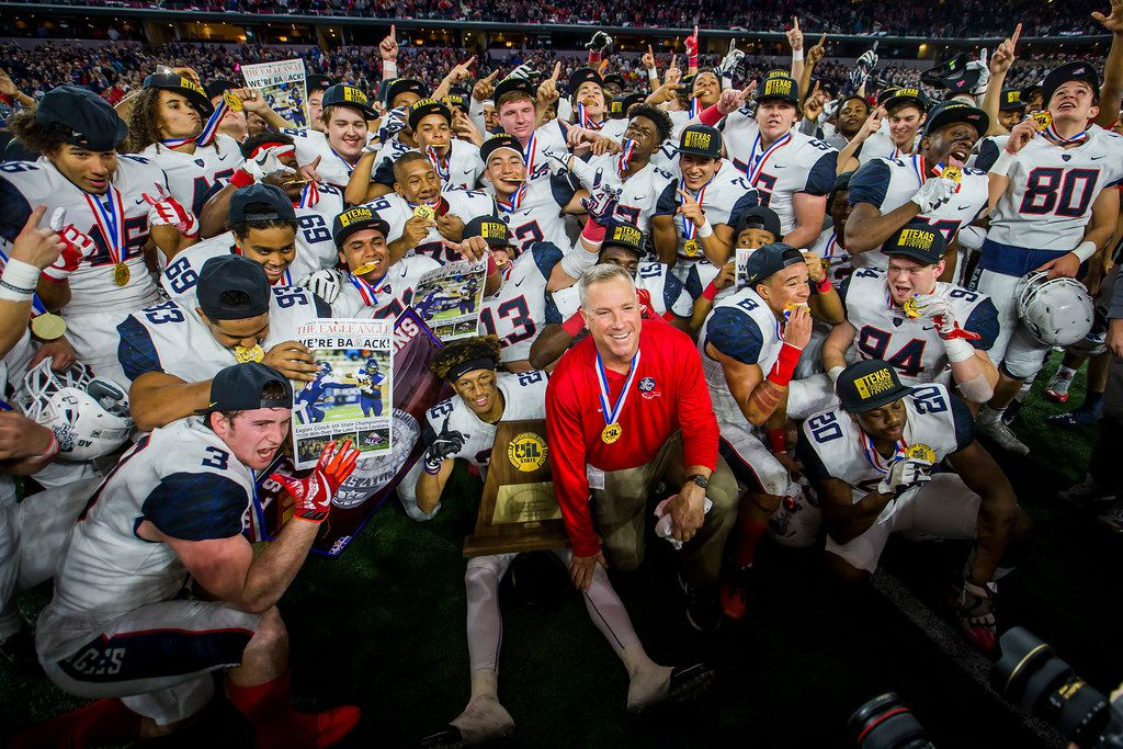 FILE - Allen head coach Terry Gambill gathers with his team for a group photo after the Eagles' 35-33 victory over Lake Travis in the Class 6A Division I state championship game at AT&T Stadium on Saturday, Dec. 23, 2017, in Arlington. (Smiley N. Pool/The Dallas Morning News)