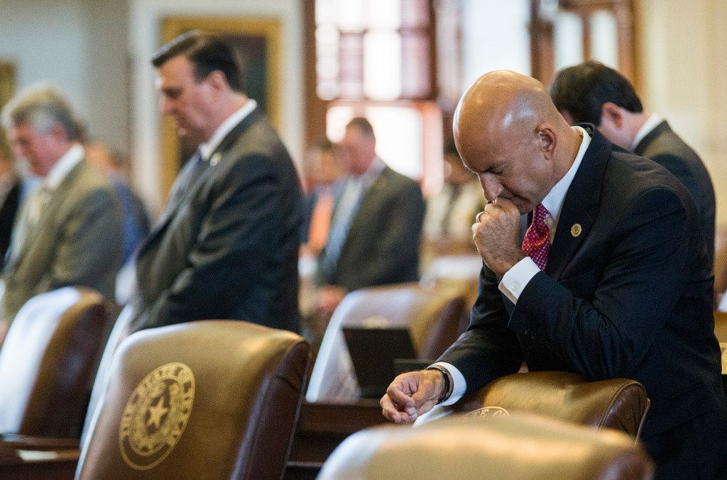 Representative Matt Shaheen of Plano and other representatives pray during the first day of a legislative special session on Tuesday, July 18, 2017 at the Texas state capitol in Austin, Texas.