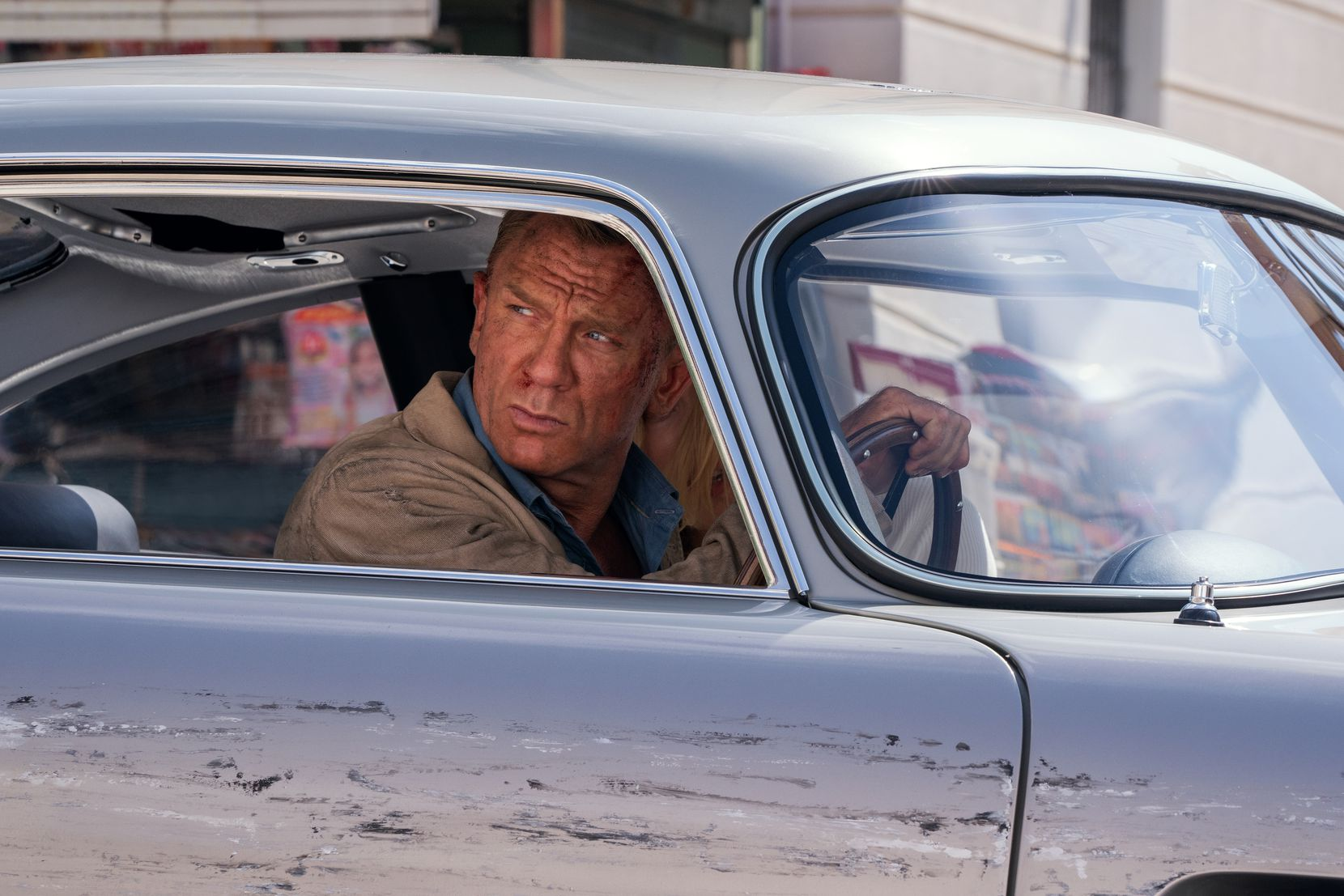 ames Bond (Daniel Craig) and Dr. Madeleine Swann (Lea Seydoux) drive through Matera, Italy in 'No Time To Die.'
