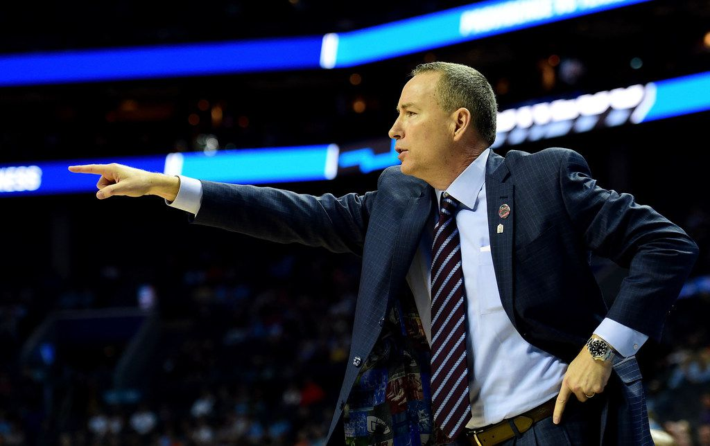 CHARLOTTE, NC - MARCH 16:  Head coach Billy Kennedy of the Texas A&M Aggies motions to his team against the Providence Friars during the first round of the 2018 NCAA Men's Basketball Tournament at Spectrum Center on March 16, 2018 in Charlotte, North Carolina.  (Photo by Jared C. Tilton/Getty Images)