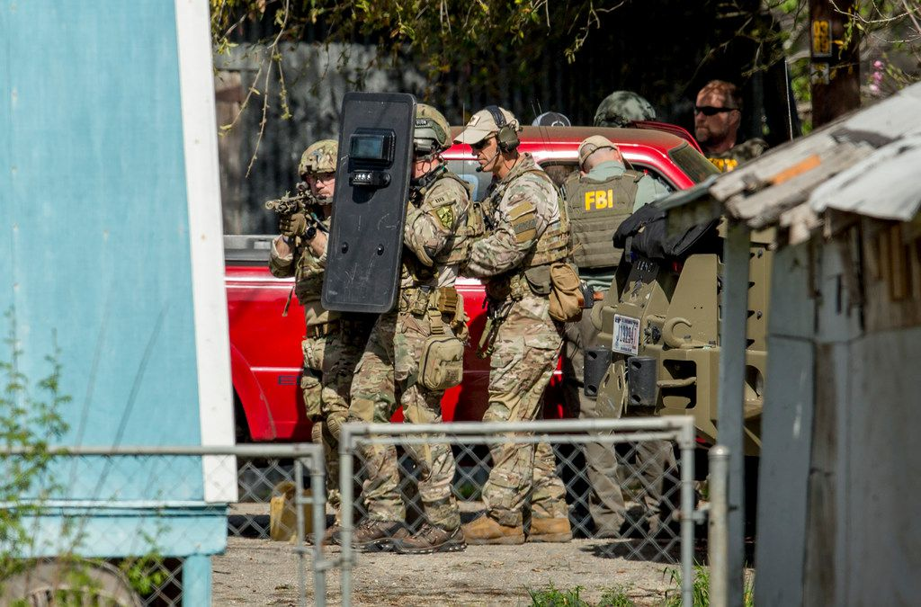 FBI agents approached the home of the Austin bombing suspect in Pflugerville on Wednesday.