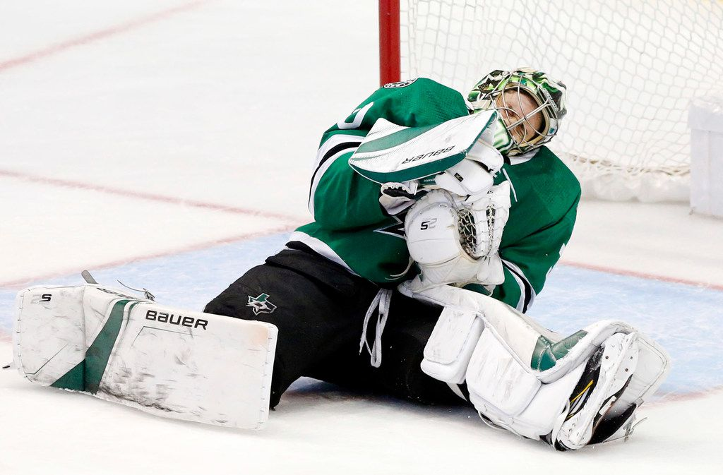 Dallas Stars goaltender Ben Bishop (30) goes to the ice after being hit by a slapshot by St. Louis Blues defenseman Colton Parayko (55) during the third period at the American Airlines Center in Dallas, Sunday, May 5, 2019. The teams were playing Western Conference Second Round Game 6 of the 2019 NHL Stanley Cup Playoffs. The Stars lost to the St. Louis Blues, 4-1. (Tom Fox/The Dallas Morning News)
