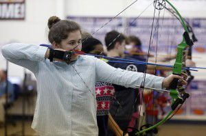 Caley Cekinobich shoots during archery practice at Allen ISD's Lowery Freshman Center. (Rose Baca/The Dallas Morning News)