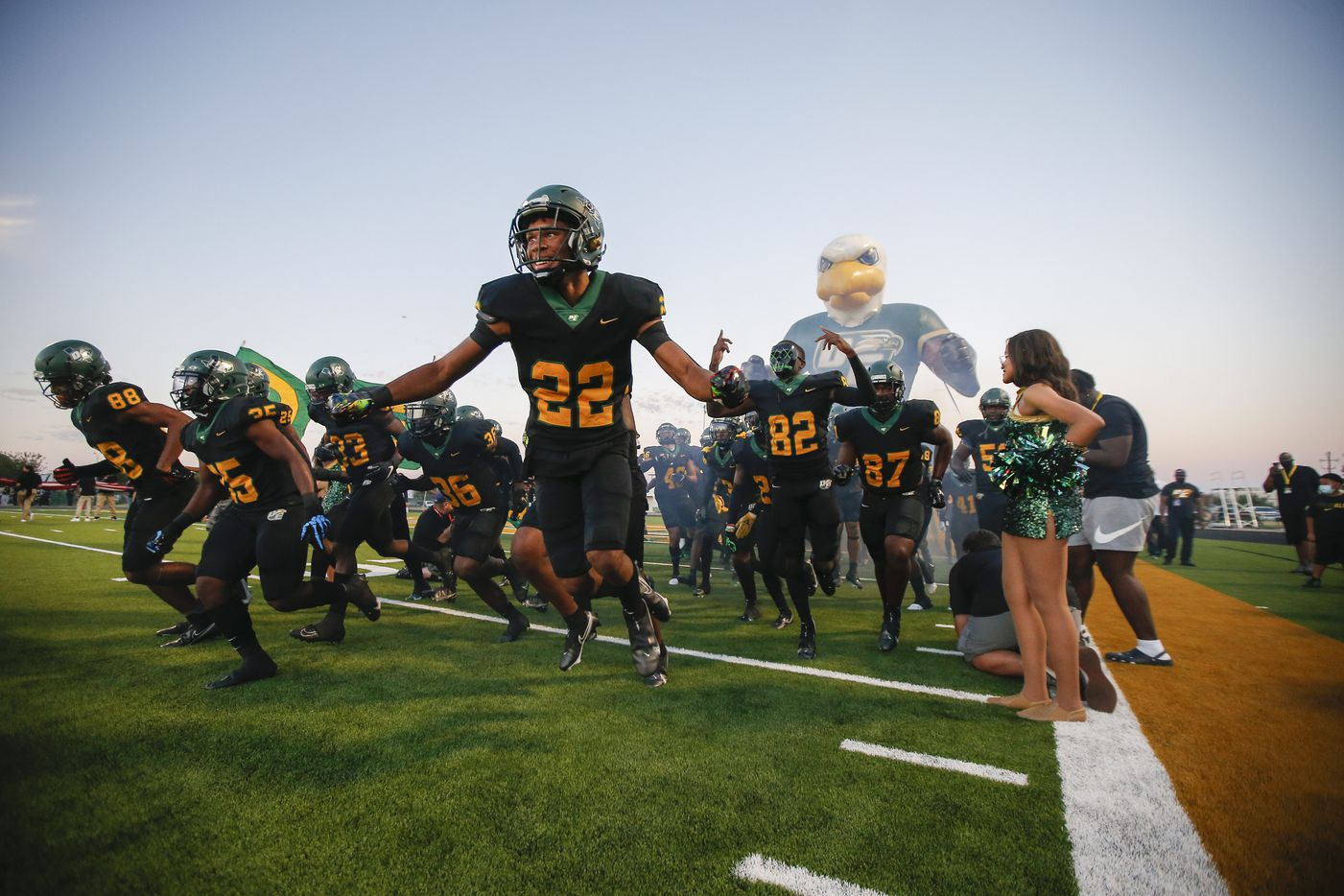 DeSoto junior defensive back Jamarion Ravenell (22) and his teammates take the field for the first half of a high school football game against Duncanville at DeSoto High School, Friday, September 17, 2021. (Brandon Wade/Special Contributor)