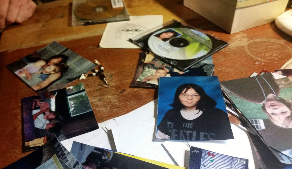 Photographs of Charles Knowles, the transgender son of Michelle Knowles, lie scattered on a table in her home in North Vassalboro, Maine. Michelle Knowles is calling for more mental resources at juvenile detention facilities following Charles' suicide. Charles, 16, who dreamed of being an LGBT activist, killed himself in November while he was temporarily detained at Long Creek Youth Development Center in South Portland, Maine. (Marina Villeneuve/The Associated Press)