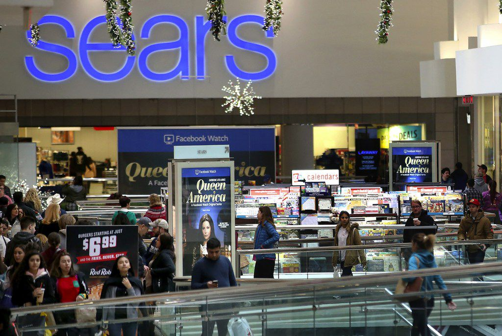Shoppers walk outside the Sears store at Woodfield Mall in Schaumburg, Ill., in November.