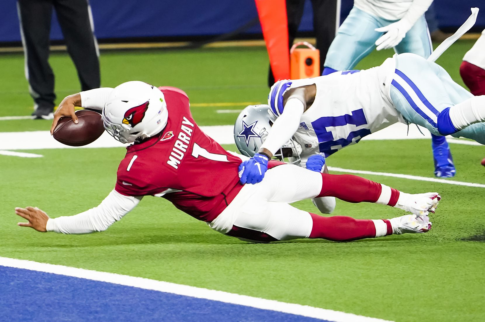 Arizona Cardinals quarterback Kyler Murray (1) dives for the end zone past Dallas Cowboys safety Donovan Wilson (37) during the second quarter of an NFL football game at AT&T Stadium on Monday, Oct. 19, 2020, in Arlington. (Smiley N. Pool/The Dallas Morning News)