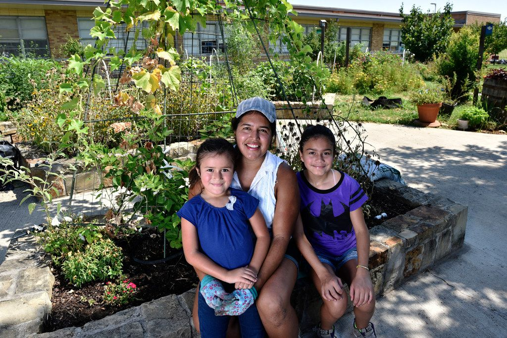 Parent and volunteer Maria Amaya, 36, with her daughters  Sophia Terry, 6, and Sarah Terry, 12, at the Edwin J. Kiest Elementary garden.