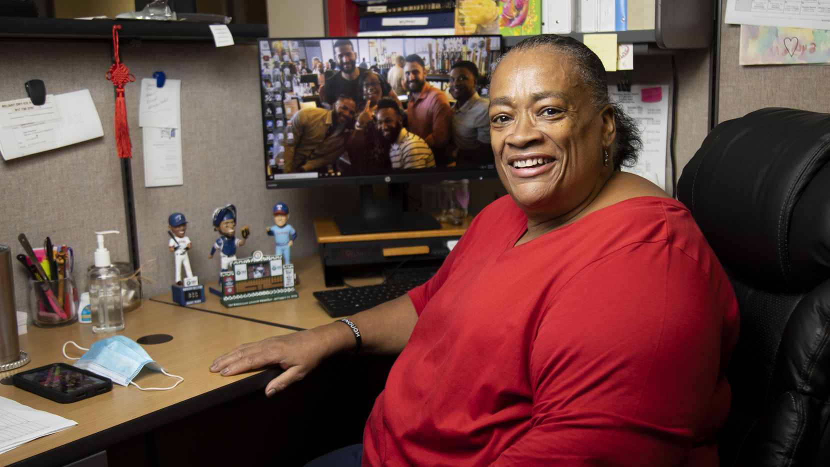Dawn Shepard, Rangers fan and Broadway Baptist Church's community center director, poses for a photo in her office on July 30, 2020, in Fort Worth. Shepard has various Rangers figures on her desk and a photo of her with players during last year's Uncork for a Cause as her computer background.