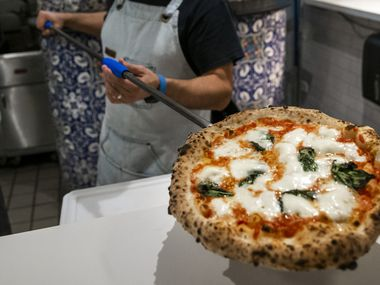 Chef Dino Santonicola prepares a margherita pizza at Partenope Ristorante in downtown Dallas.