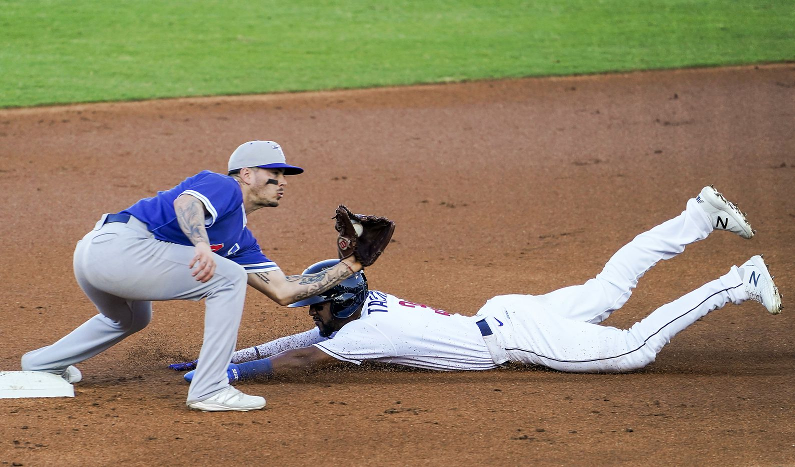 Round Rock Express outfielder Leody Taveras steals second base ahead of the tag from Oklahoma City Dodgers second baseman Omar Estevez during the first inning at Dell Diamond on Thursday, May 6, 2021, in Round Rock, Texas.