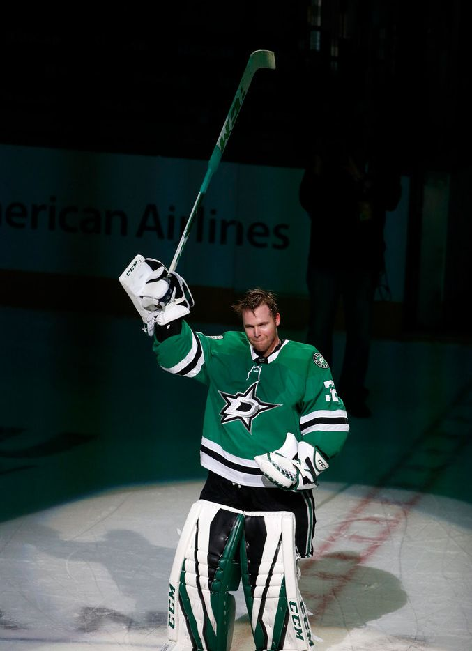 Dallas Stars goaltender Kari Lehtonen (32) reacts to cheers from fans after an overtime win over the Philadelphia Flyers during an NHL hockey game in Dallas, Tuesday, March. 27, 2018. (AP Photo/Michael Ainsworth)