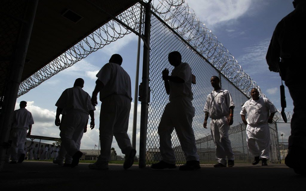 Inmates walking to the Chow Hall at the L.V. Hightower Unit in Dayton, Texas on July 16, 2014. Hightower is one of 41 state-run jails and prisons with at least one active case of the coronavirus. In-class instruction for inmates will resume at all units without active cases.