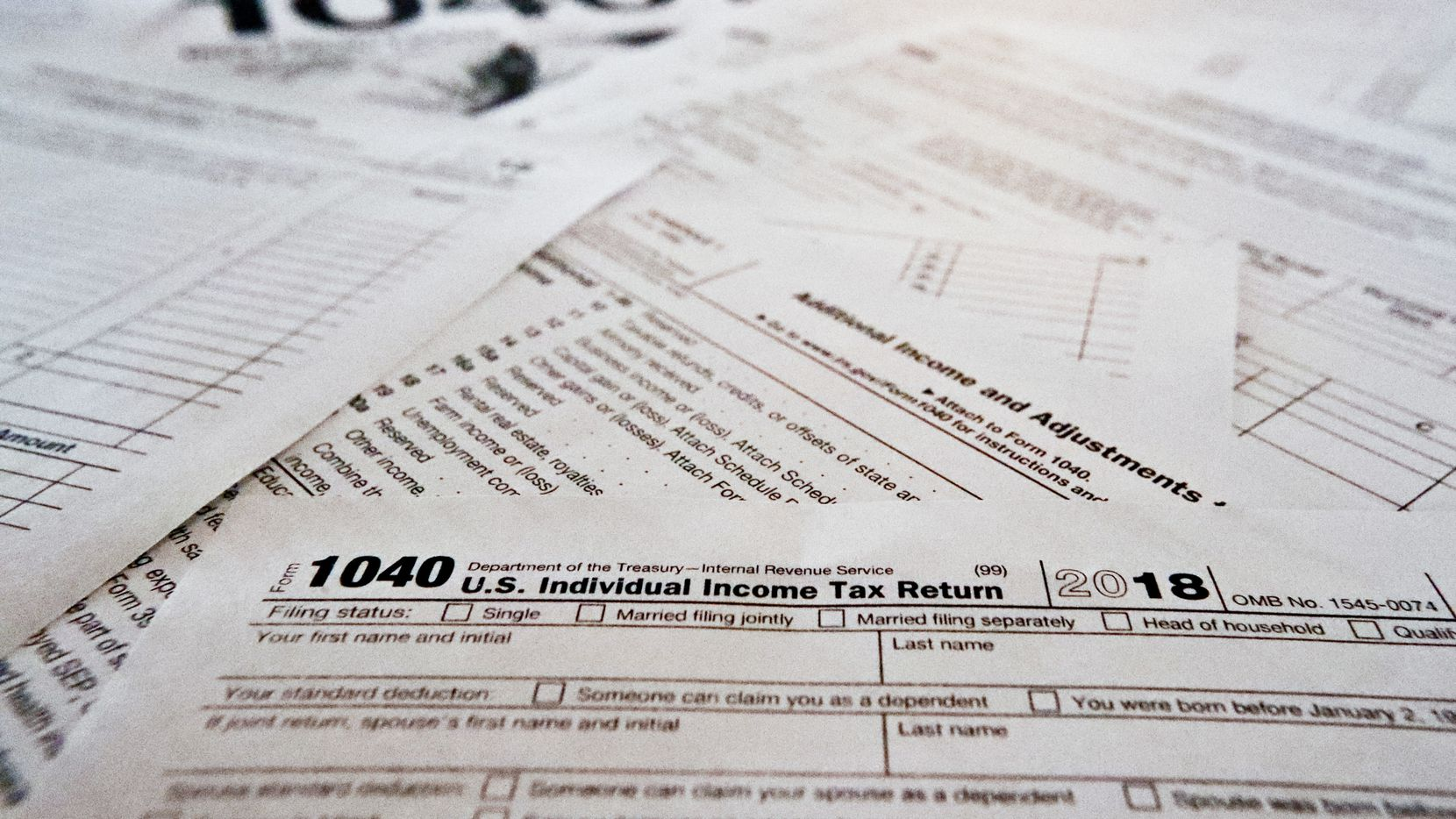 This Wednesday, Feb. 13, 2019, photo in Zelienople, Pa., shows multiple forms printed from the Internal Revenue Service web page that are used for 2018 U.S. federal tax returns.