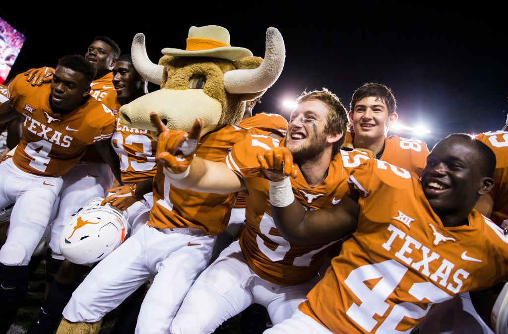 The Texas Longhorns celebrate a 37-14 win over the USC Trojans on Saturday, September 15, 2018 at Darrell K Royal Memorial Stadium in Austin, Texas. (Ashley Landis/The Dallas Morning News)
